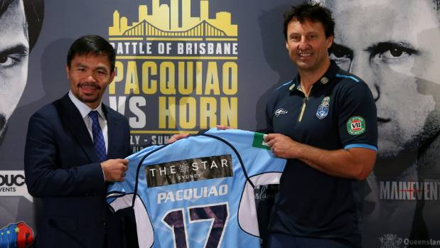 Manny Pacquiao is presented with his State of Origin jersey by NSW Blues coach Laurie Daley.