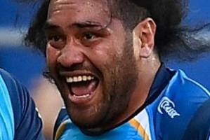 Konrad Hurrell celebrates after scoring a try against the Knights.