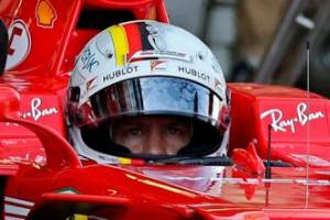 Ferrari mechanics push Sebastian Vettel ahead of qualifying in Russia.