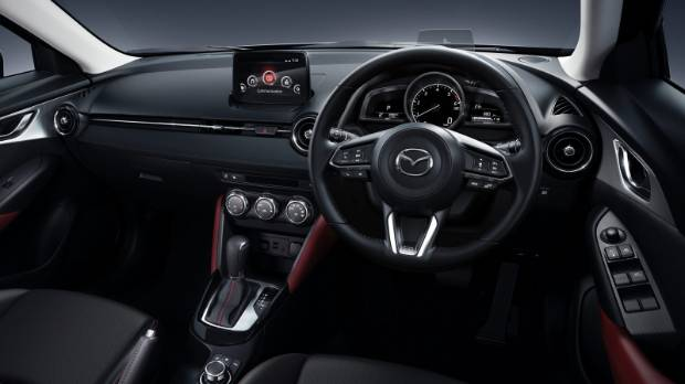 CX-3 interior gets new steering wheel and changes to instrumentation.