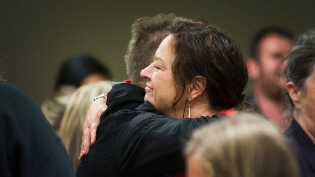 Sue Moroney gets a hug from a supporter on Sunday at a panel discussion about a commuter train service between Hamilton ...