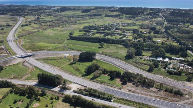 The old SH1 at the bottom of the picture at Peka Peka, with the new Kapiti Expressway in the middle. The road curving ...
