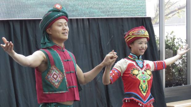 Dancers during a display of Tujia performance art at the opening.