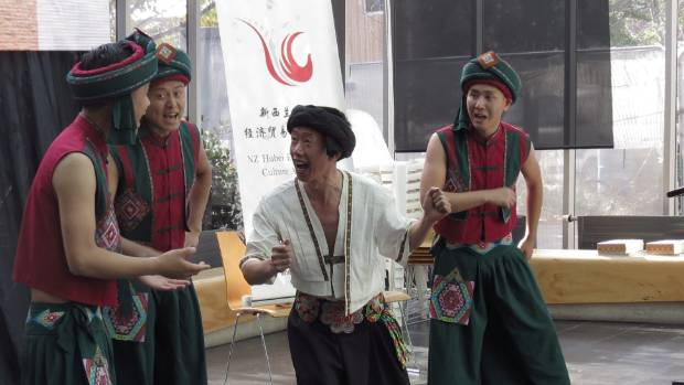 Dancers performing a song about catching crabs, a popular catch in Enshi.