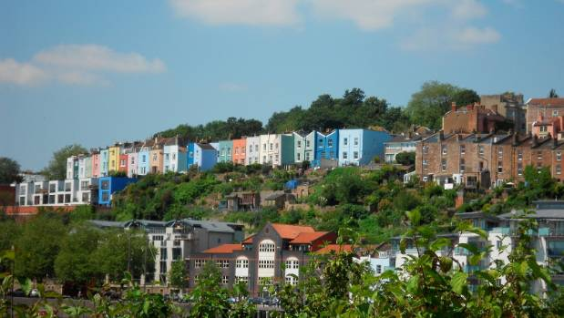 Candy-coloured houses line the landscape of Bristol, The city is sometimes overlooked for Bath - but it's fighting back ...