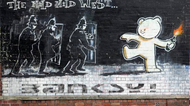 Banksy's 'Mild Mild West' adorns a wall in Stokes Croft.