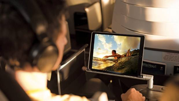 The nifty tablet holders fold into the armrest.