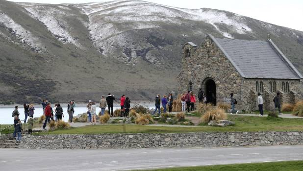Tourists visiting the Church of the Good Shepherd in Tekapo. Record visitor numbers have boosted employment in tourism ...