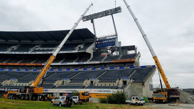Cranes remove the lights at Lancaster Park earlier this year.