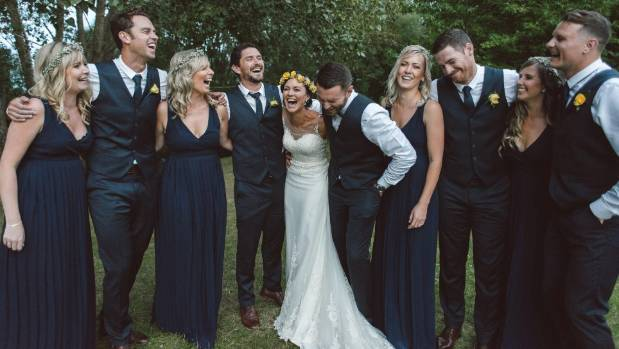 The bridal party share a laugh.