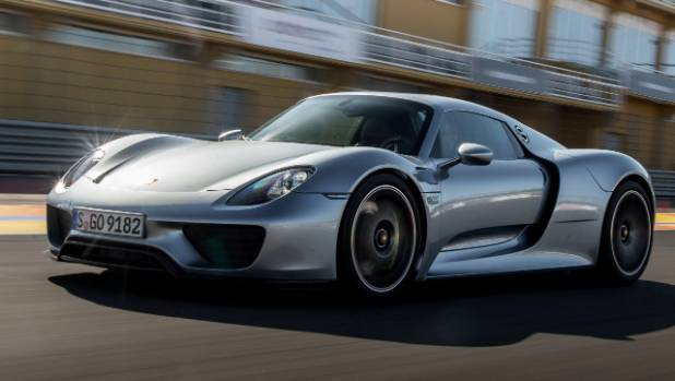 Manchester United' s Zlatan Ibrahimovic's love of fast cars extends to the Porsche 918 Spyder which he can park ...