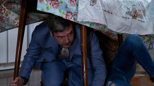Shortland Street actor Grant Lobban, who plays IT guy Damo Johnson, hides beneath a table as an earthquake hits ...