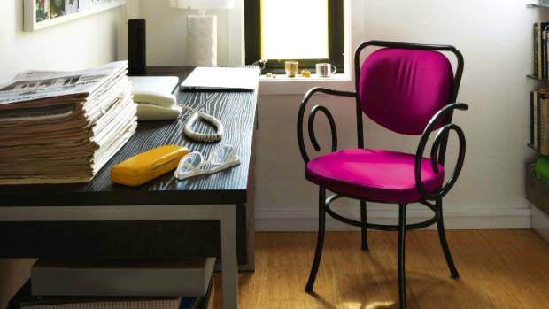 Office furniture doesn't have to be dull - a bright pink chair makes this workspace feel fun.