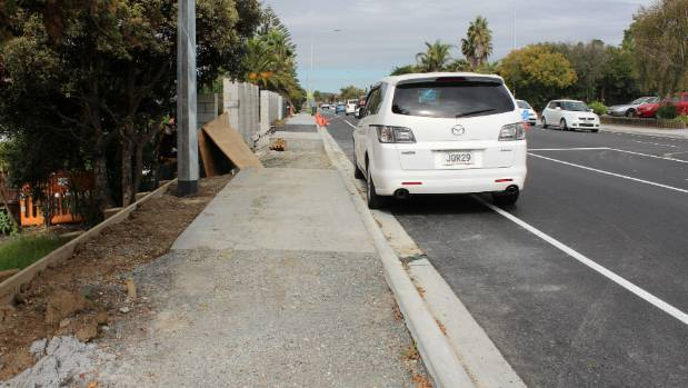 Some Te Atatu Rd residents have complained finishing work on their driveways is delayed.