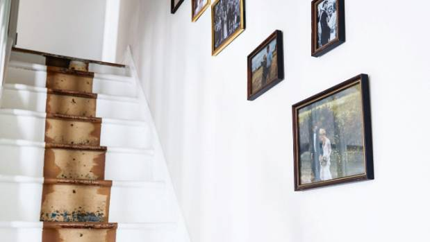 The Norwoods left a strip of wood unpainted on the stairs to preserve some of the home's history.