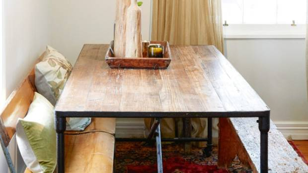 The recycled pine dining table and copper light are both from CC Interiors; an old school bench and vintage stools are ...