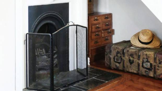 An antique trunk sits under the stairs – it's the perfect spot for storing firewood.