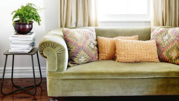 The rolled arm velvet couch was originally Amanda's grandfather's and influenced the colour scheme of the room.