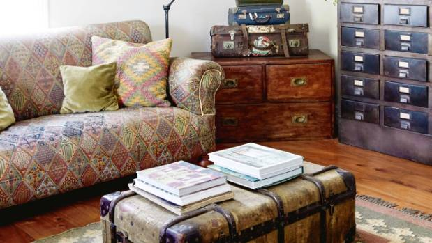 The coffee table in the living room is an old trunk Amanda discovered in a junk shop – it has the original fabric lining ...