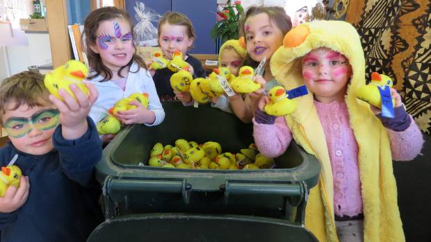 Children from Havelock North Central Kindergarten with one of the wheelie bins full of ducks.