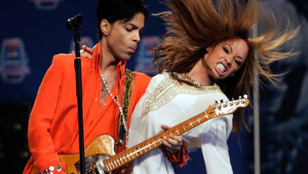 Prince, left, performs in Florida in 2007. His genius is still impossible to explain.