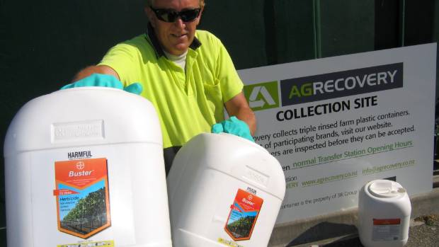 Grant Mathieson, transfer station attendant, with agricultural chemical containers that can be recycled in Marlborough ...
