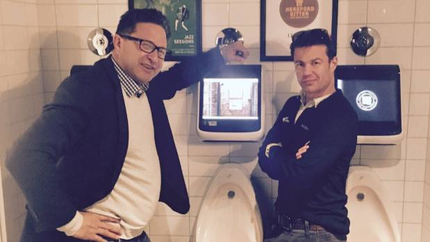 Nicholas Henare and Jonny Kirkpatrick with their interactive urinal games at Dux Central in Christchurch.