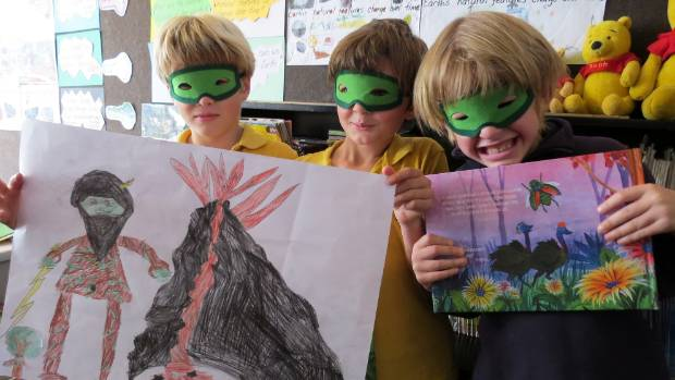 A group of Mt Pleasant Primary School pupils with their poster of a tree god and an exploding volcano.