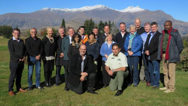 Department of Conservation Director General Lou Sanson and Wakatipu operations manager Geoff Owen, both kneeling at the ...