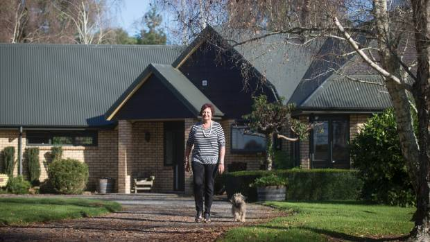 Chele Clarkin and her dog Nemo at their new home on Tarr Road.