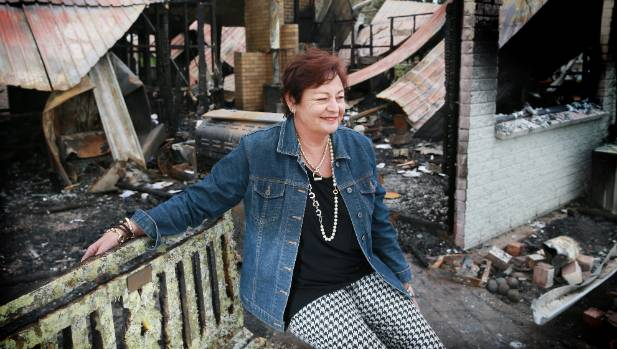 Chele Clarkin at her home of 20 years, which burnt down in August.
