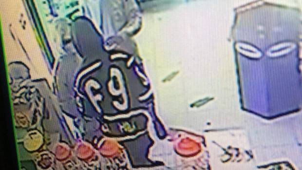 2d9e49a9c7d90 One was wearing a hoodie with 69 on the back and carrying a black Adidas bag