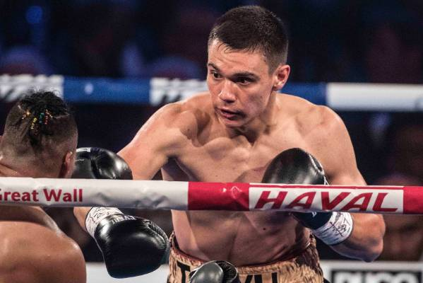 Tim Tszyu, right, defeated Ivana Siau by TKO.