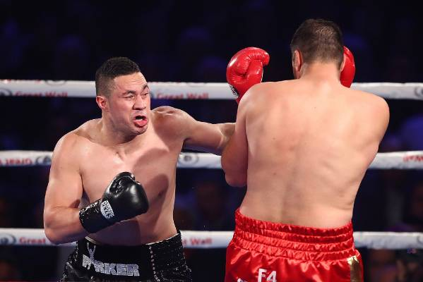 Joseph Parker throws a left hand at Razvan Cojanu.