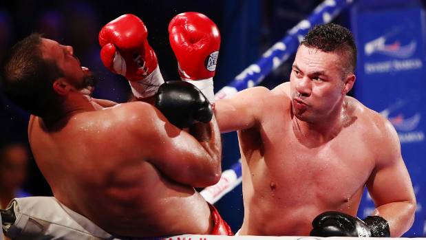 Joseph Parker strikes with Razvan Cojanu on the ropes.