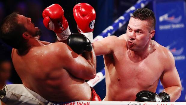 New Zealand's Joseph Parker corners Razvan Cojanu of Romania during his defence of the the WBO world heavyweight title.