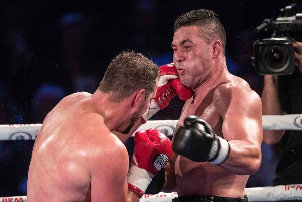 Joseph Parker takes a shot to the face.