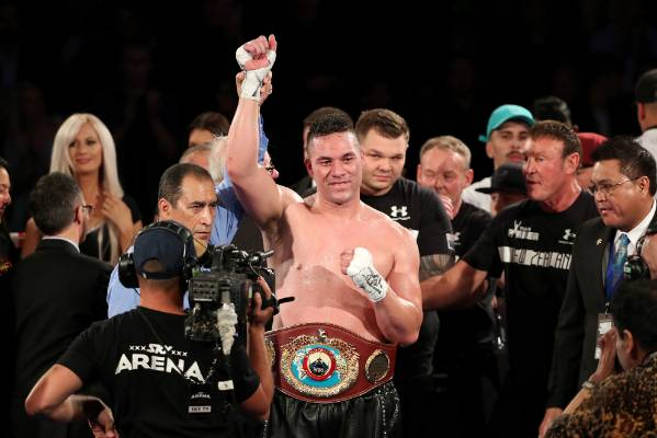 Joseph Parker celebrates a successful world title defence with his team.