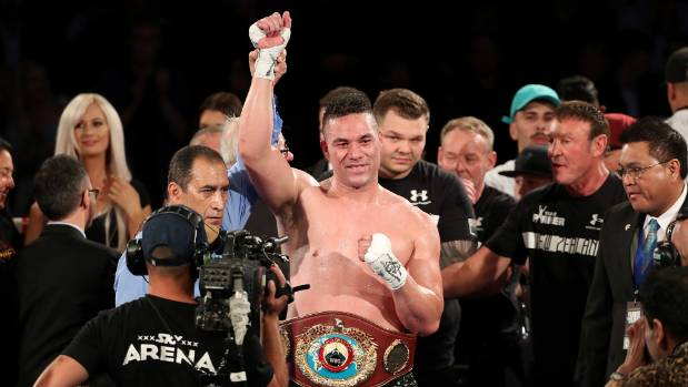 Joseph Parker celebrates his world title defence with his team.