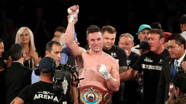 Joseph Parker celebrates his successful title defence with his team.