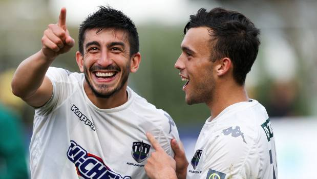 Auckland City's Emiliano Tade and Clayton Lewiscelebrate after winning the OFC Champions League final.
