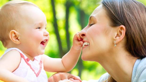 Look how happy motherhood makes me ... okay, you got me. This is just an adorable stock photo.
