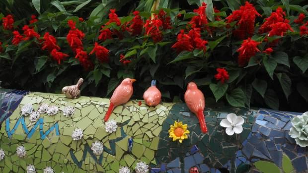 Life-sized birds can be seen in the garden.