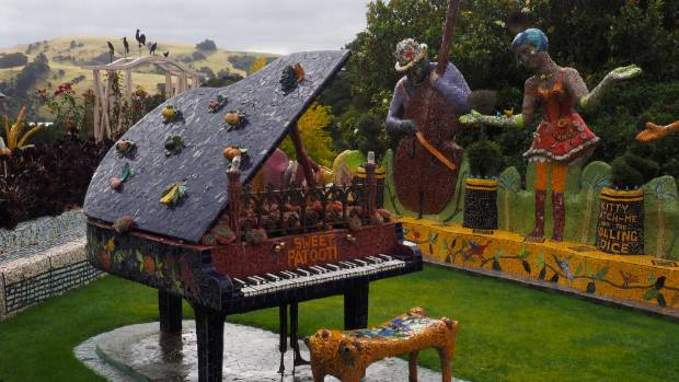 A full-size grand piano outside the main entrance, along with an accompanying band.