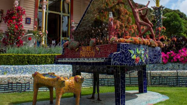 A full-size grand piano outside the main entrance.