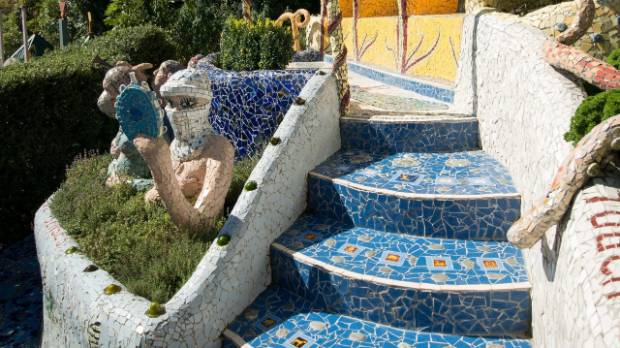 It's all mosaic: paths, steps and walls, benches, arches and seats.
