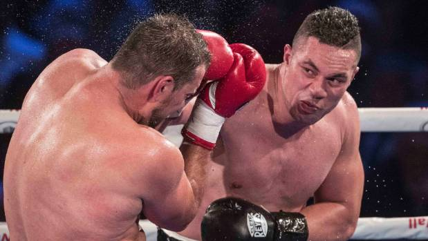 WBO heavyweight champion Joseph Parker on the attack against Romania's Razvan Cojanu.