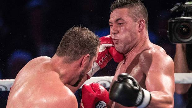 Joseph Parker showed the strength of his jaw as he defended his WBO title against big Romanian Razvan Cojanu.