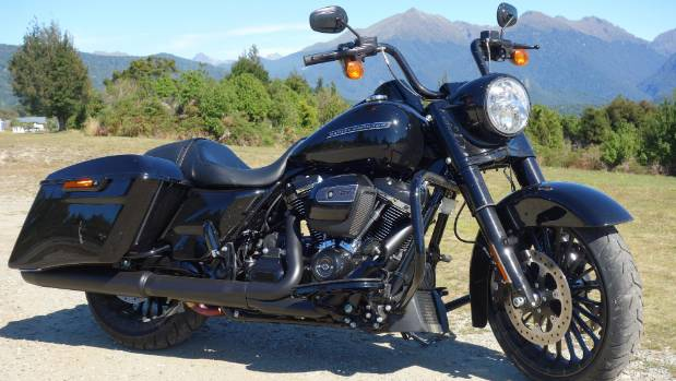 Lowered stance, blackout of all the shiny bits and the ditching of the windshield identify the special Road King.