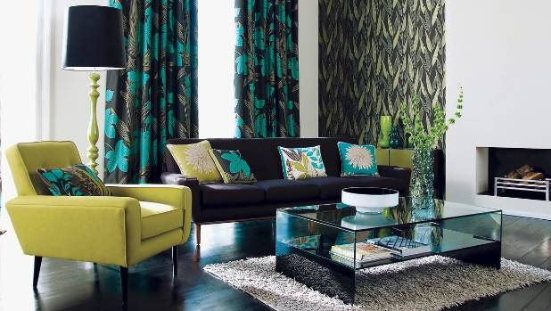 A mix of patterns and textures come together in this cool-toned, contemporary living room.